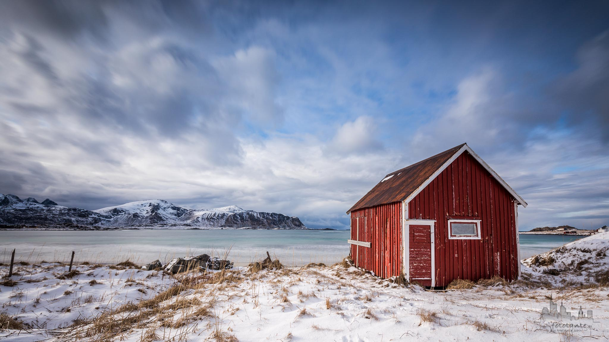 Red hut at Ramberg beach, Lofoten, Norway