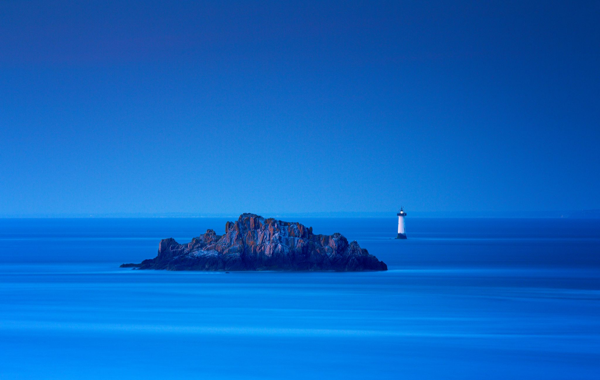 Last light on lighthouse, France