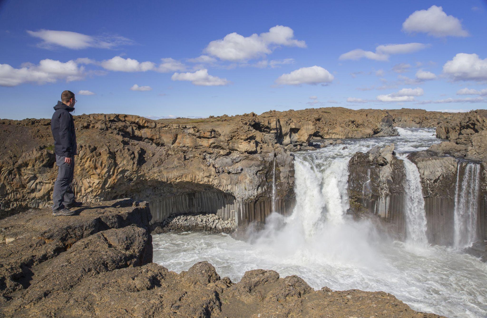 Traveler near Aldeyjarfoss Waterfall in Iceland, Iceland