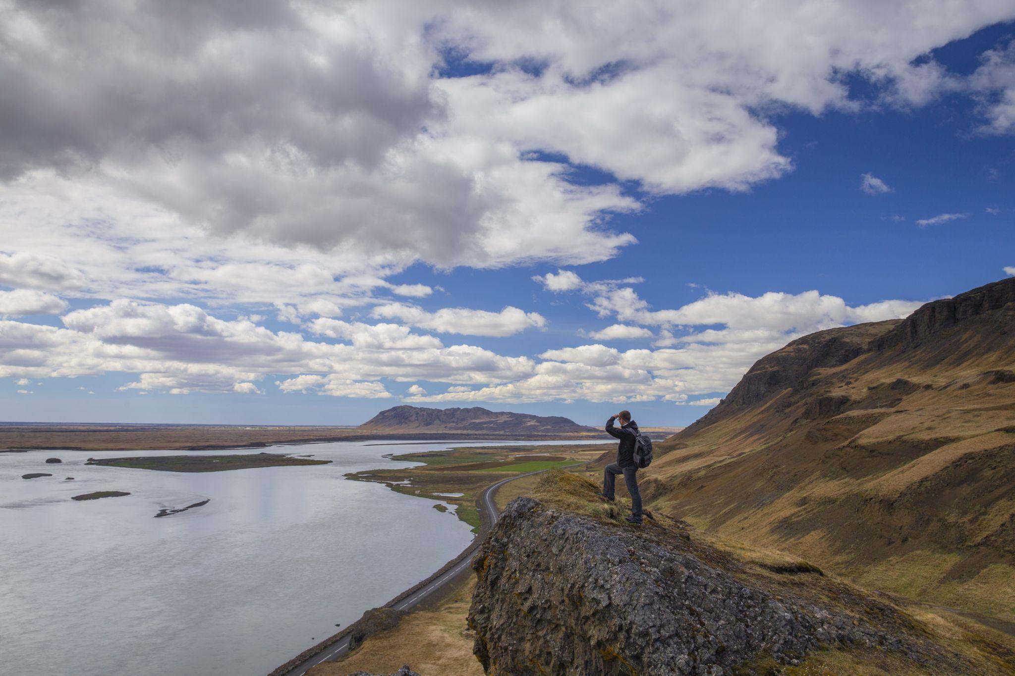 Traveler on peak of mountain in Asolfsstadhir, Iceland, Iceland