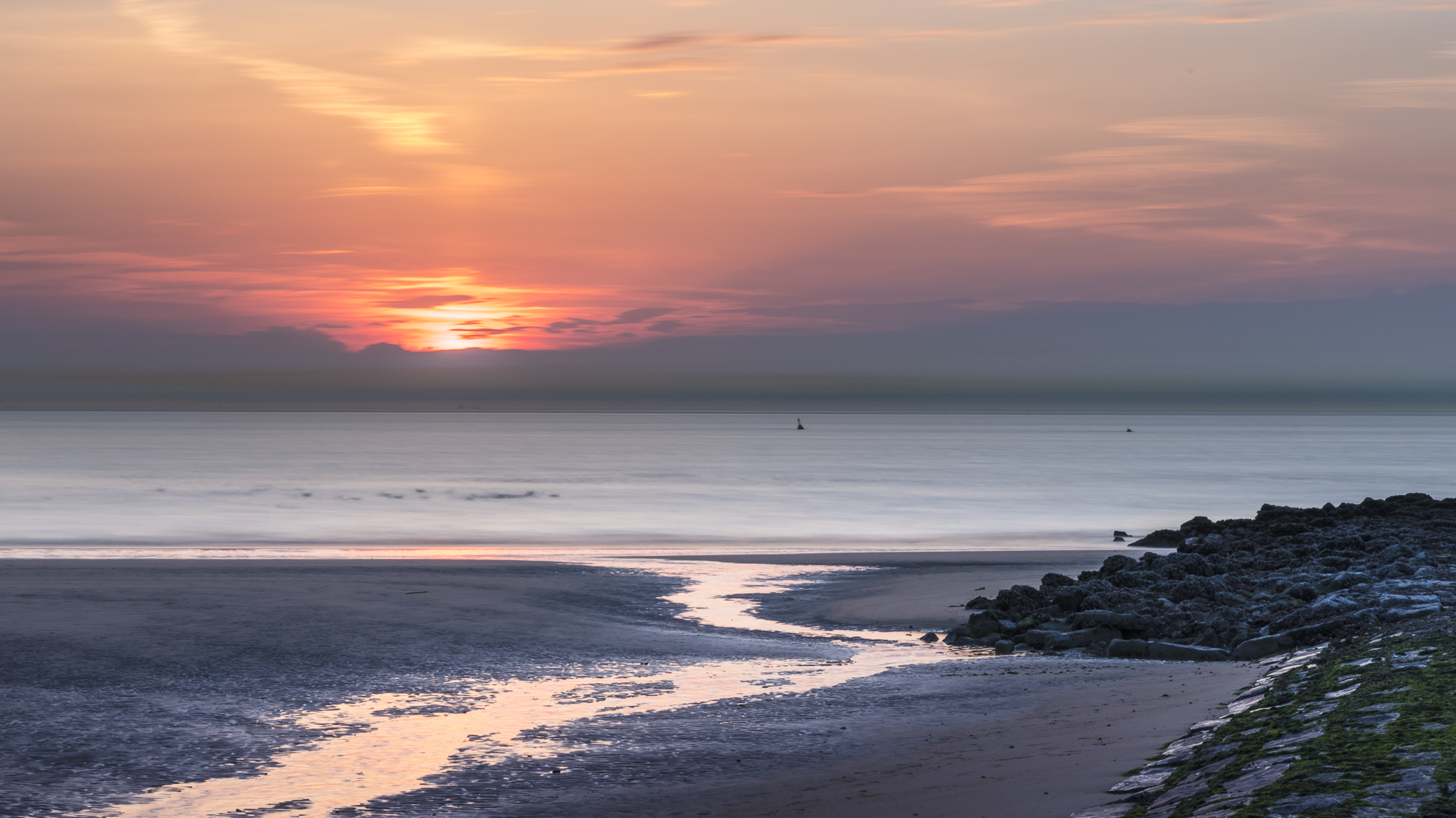 Sunset Belgian coast at low tide, Belgium