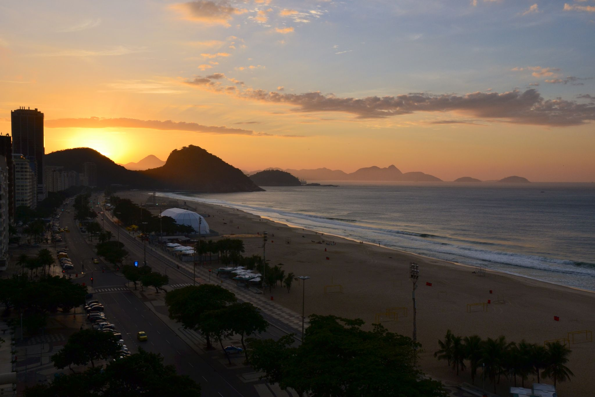 Sunrise over Copacabana beach from one of the hotels., Brazil