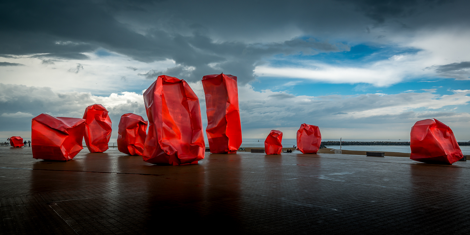 Red 'Rock Strangers' Sculpture at harbour's mouth in Ostend, Belgium