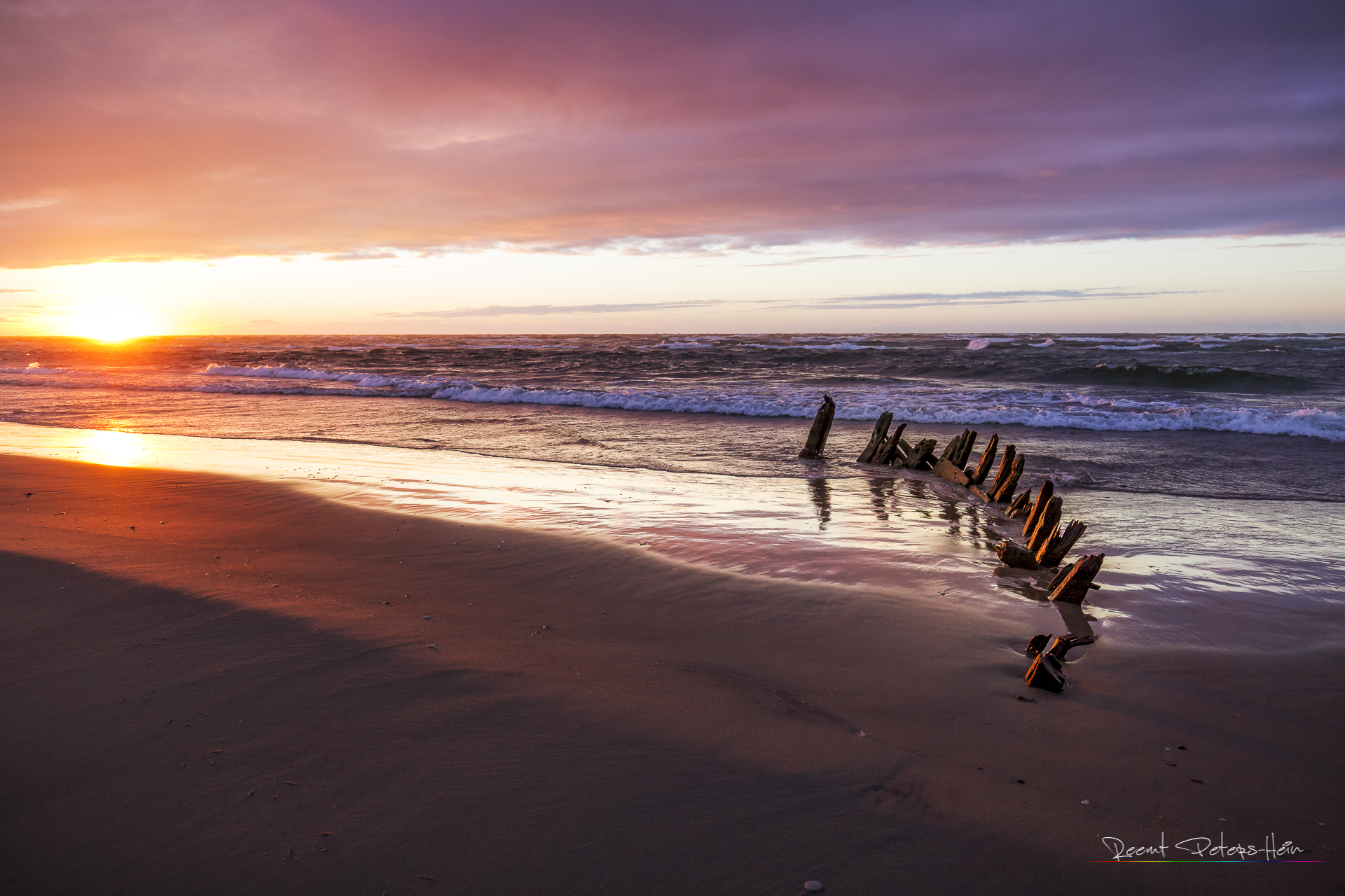 Beach of Hirtshals with a little shipwreck, Denmark