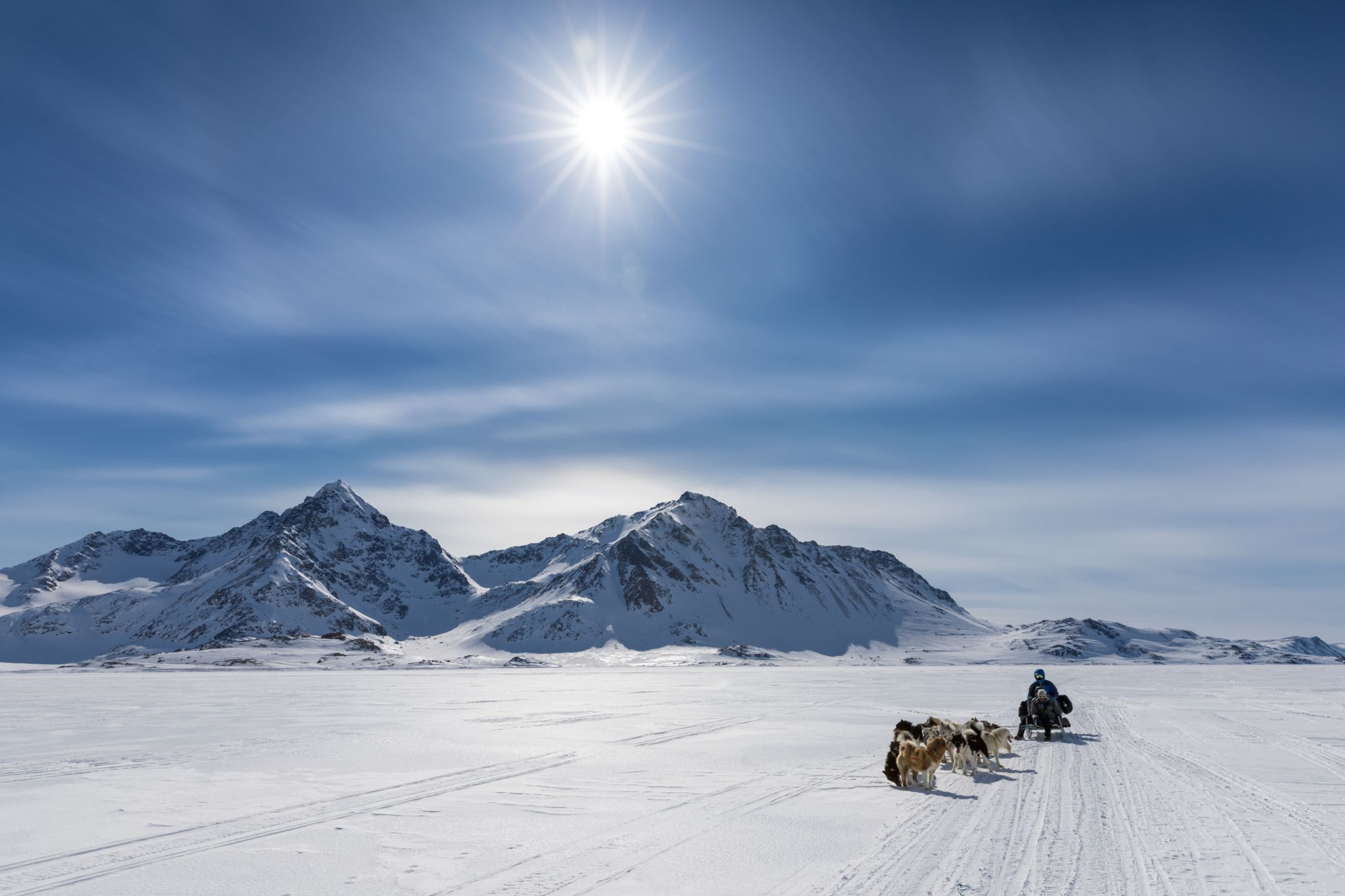 Travelling on the frozen sea ice of East Greenland, Greenland