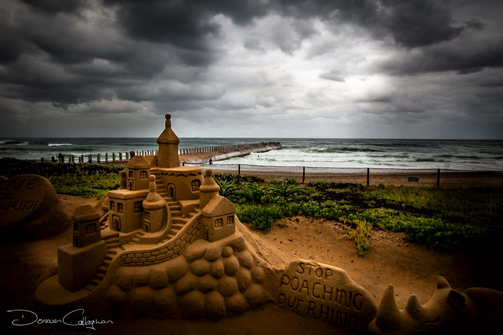 Stormy Durban beach with sand Castle, South Africa
