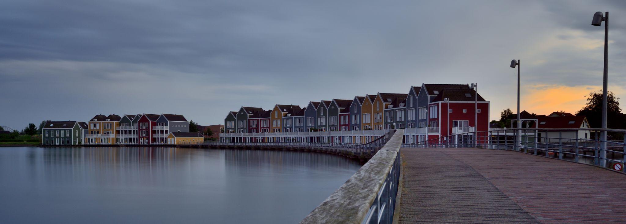 Rainbow colored houses on Rietplas, Houten, Netherlands