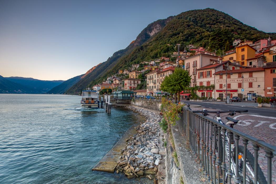 Argegno Ferry leaving the wharf Lake Como, Italy