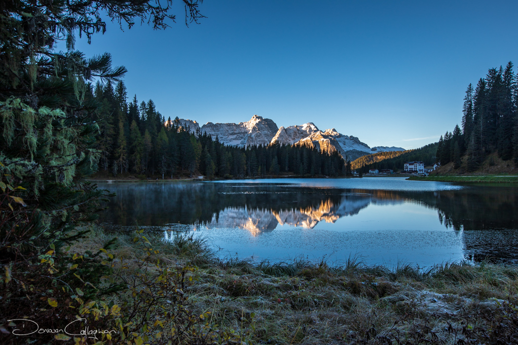 Lake Misurina snow covered peaks sunrise Dolomites, Italy