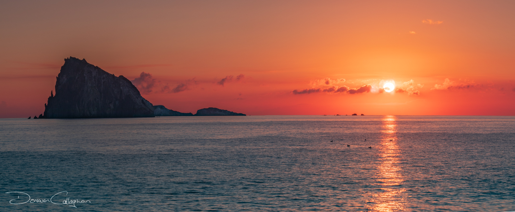 Panarea the sun is rising over the island of Dattilo, Italy