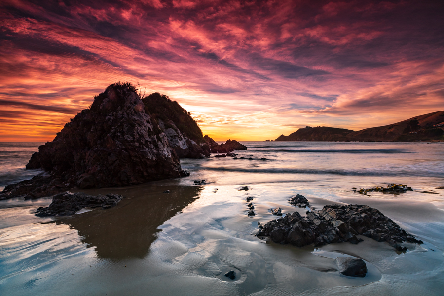 Looking back to Nugget Point at sunrise, New Zealand