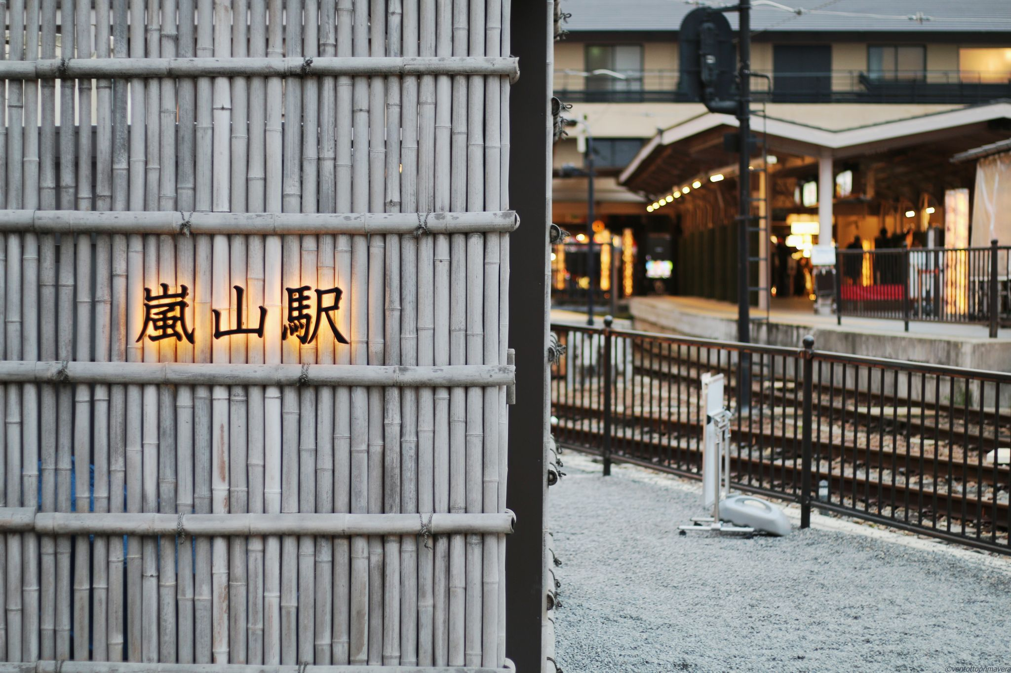 Randen Arashiyama Station name on bamboo fense, Japan