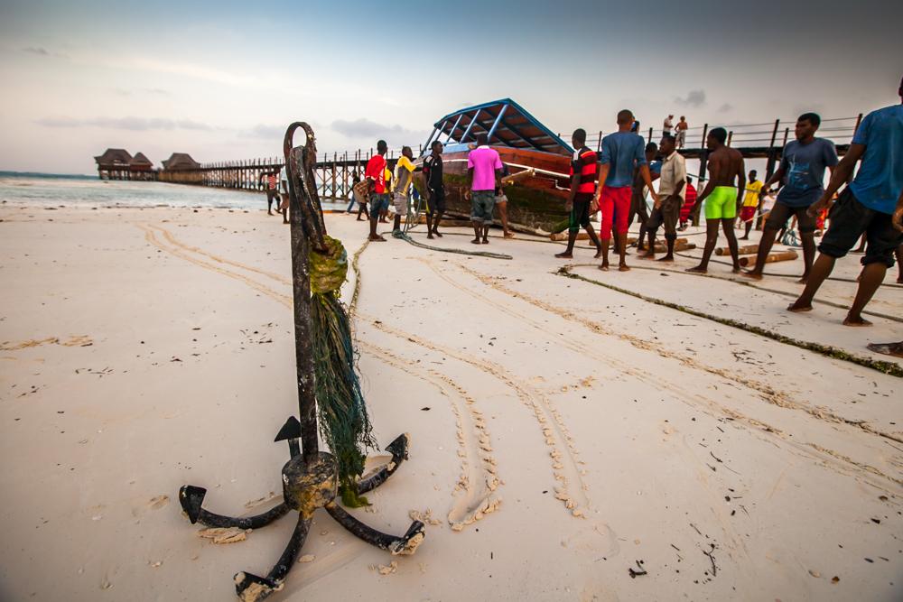 Bringing in the boat Dongwe Zanzibar, Tanzania