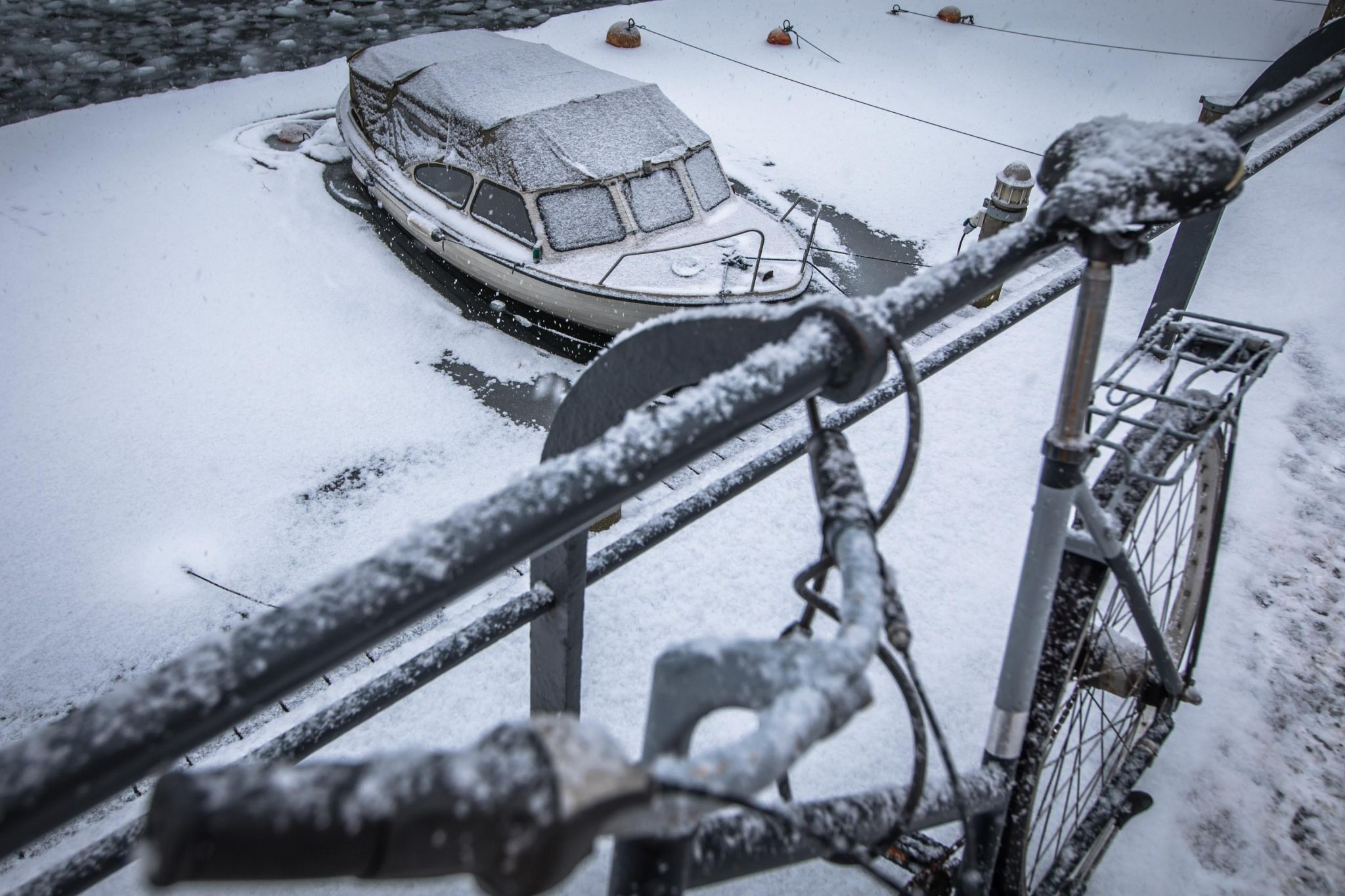 Copenhagen Bicycle & boat in the snow, Denmark