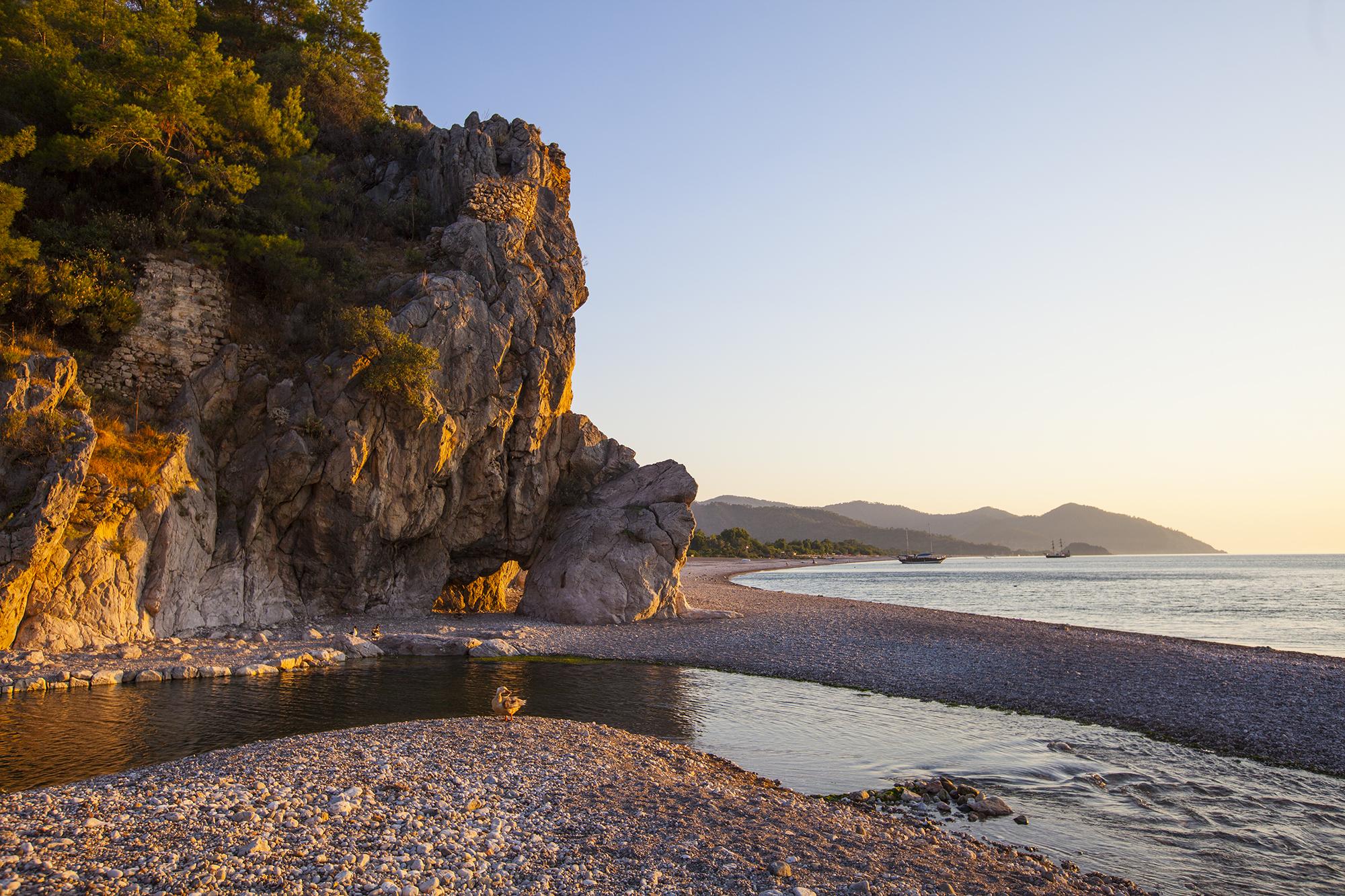 Natural arch in the rock, Cirali beach, Turkey