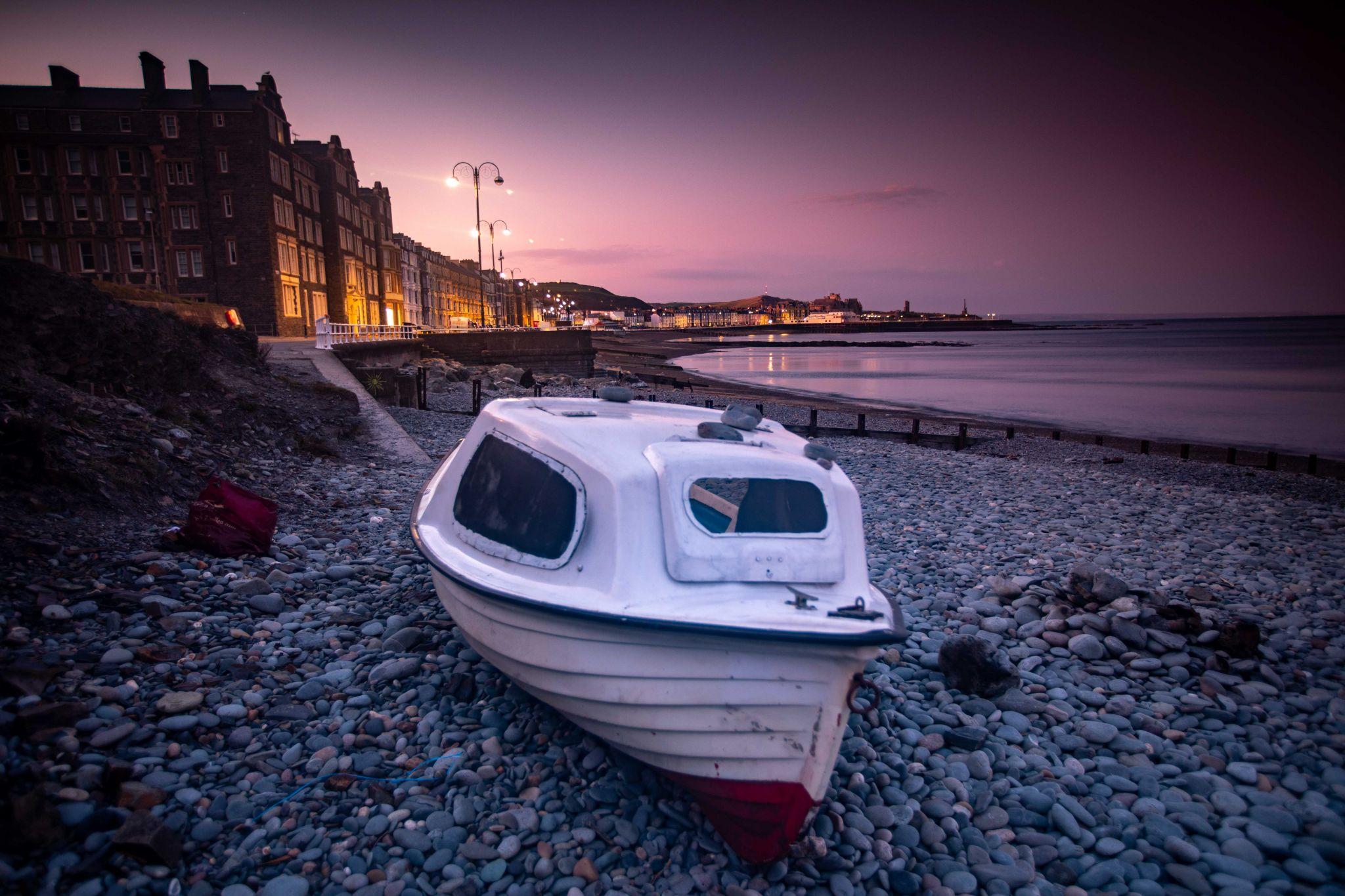 Aberystwyth Sunrise Boat on the beach Wales, United Kingdom