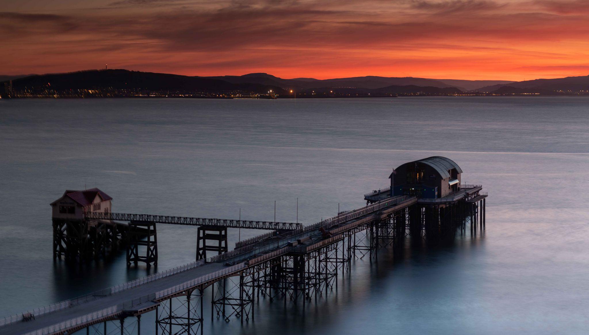 Mumbles Pier & Life Boat station sunrise Wales, United Kingdom
