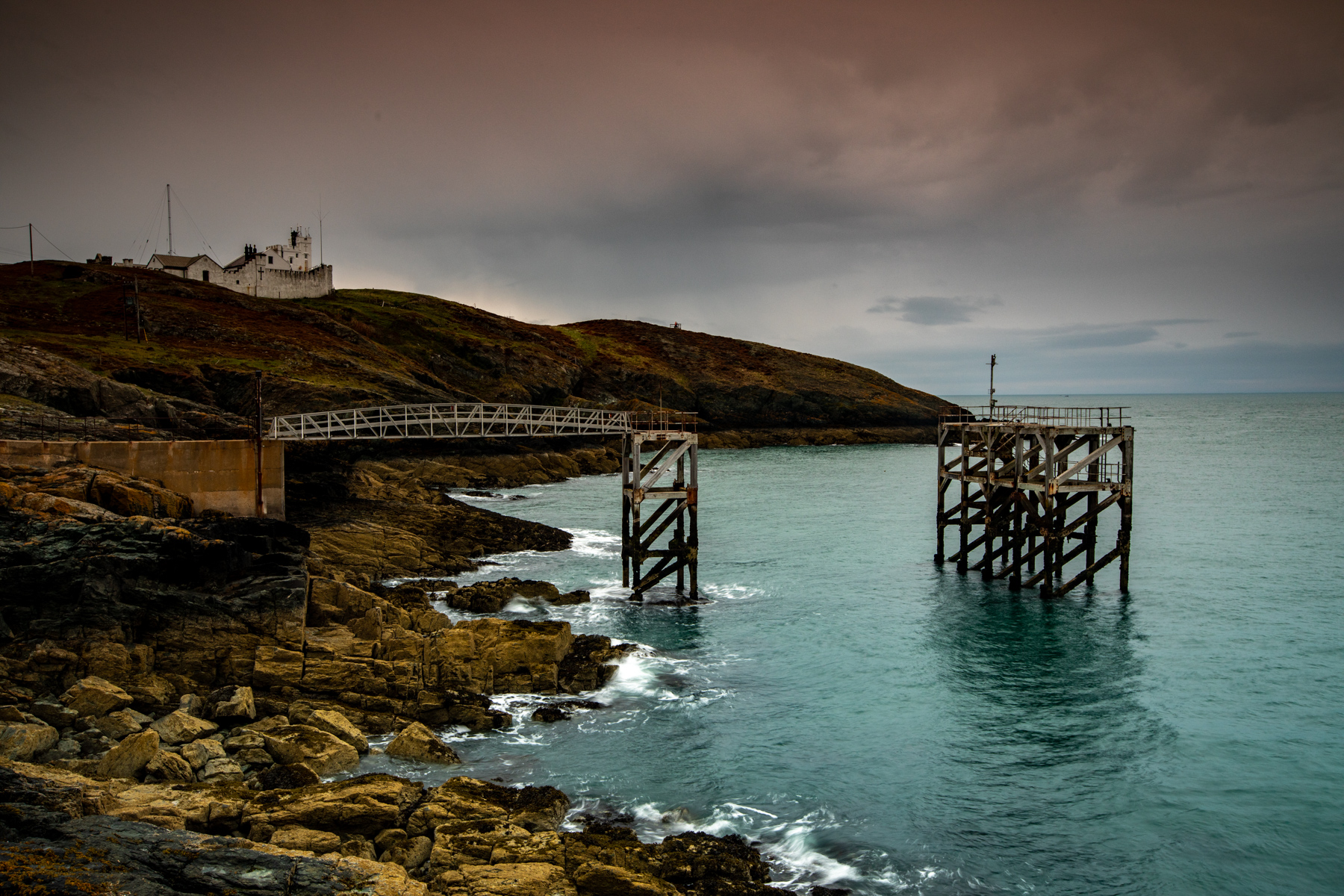 Point Lynas Lighthouse with wharf Wales, United Kingdom