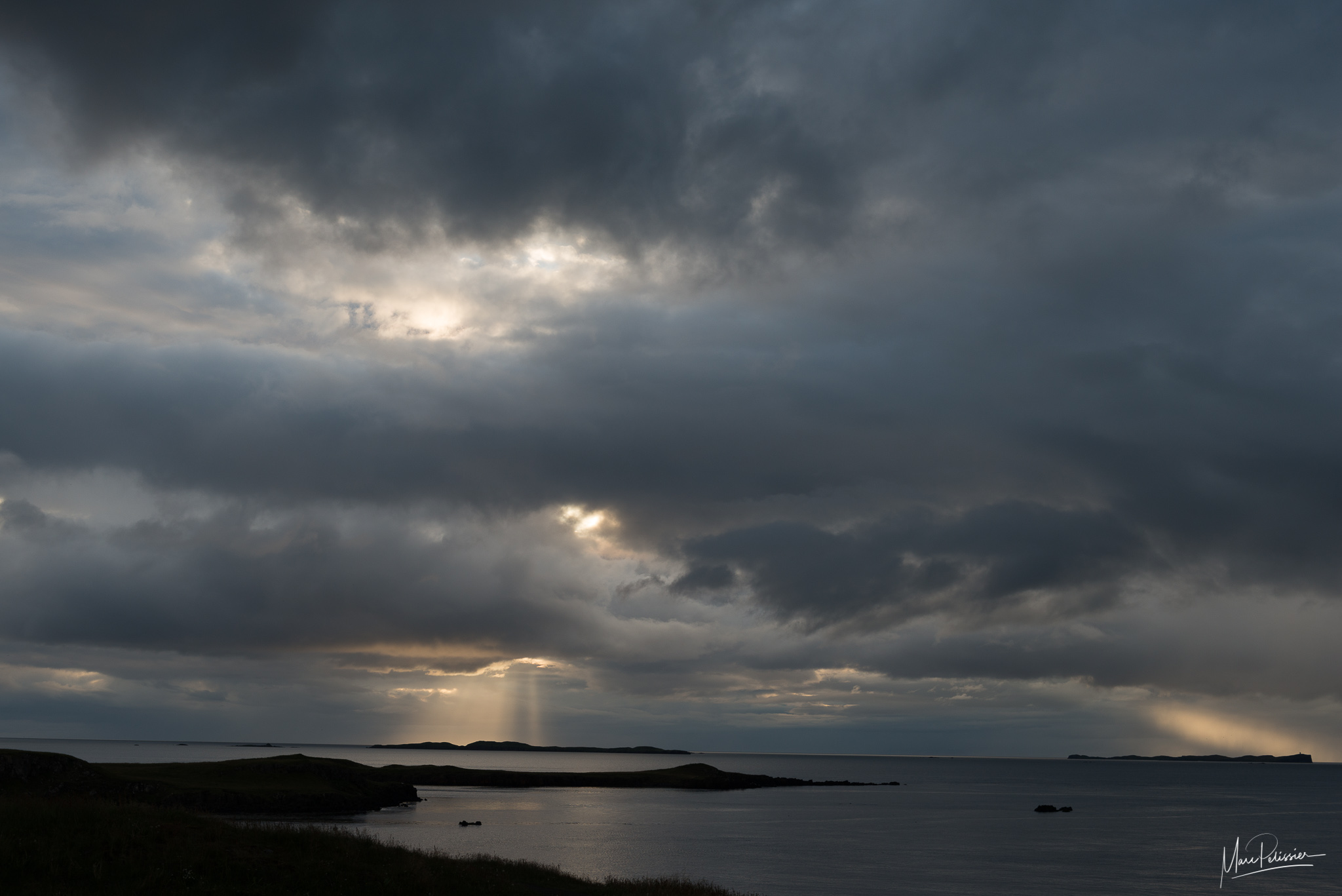 Cloudy sunset from Súgandisey Island Lighthouse, Iceland