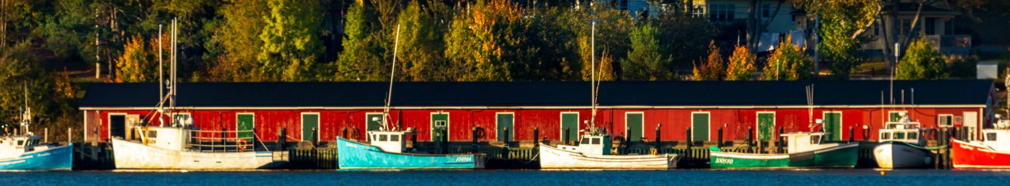 Fishing boats, red fishing sheds, Lunenburg, Nova Scotia, Canada