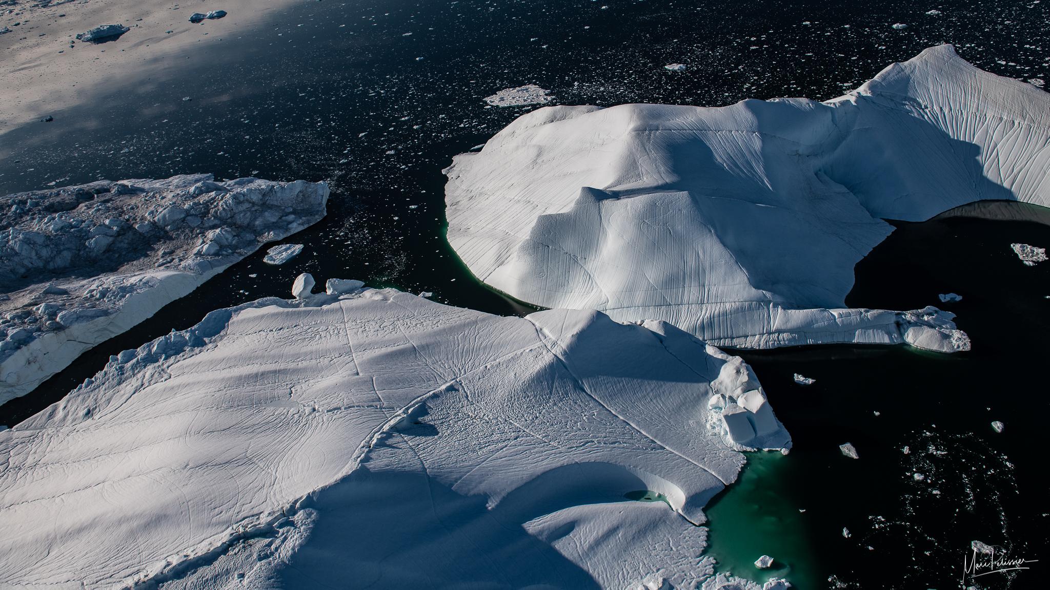 Flying above the iceberg of Sermeq Kujalleq glacier, Greenland