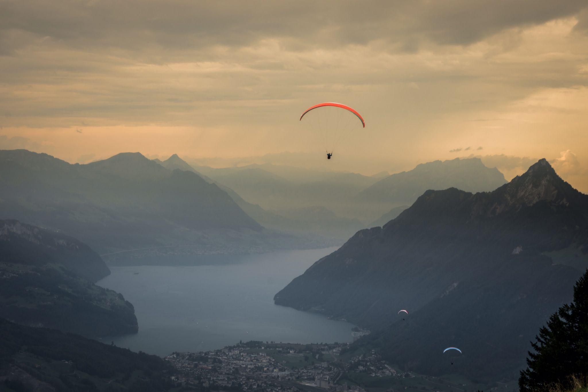 Paragliders above Lake Lucerne, Switzerland