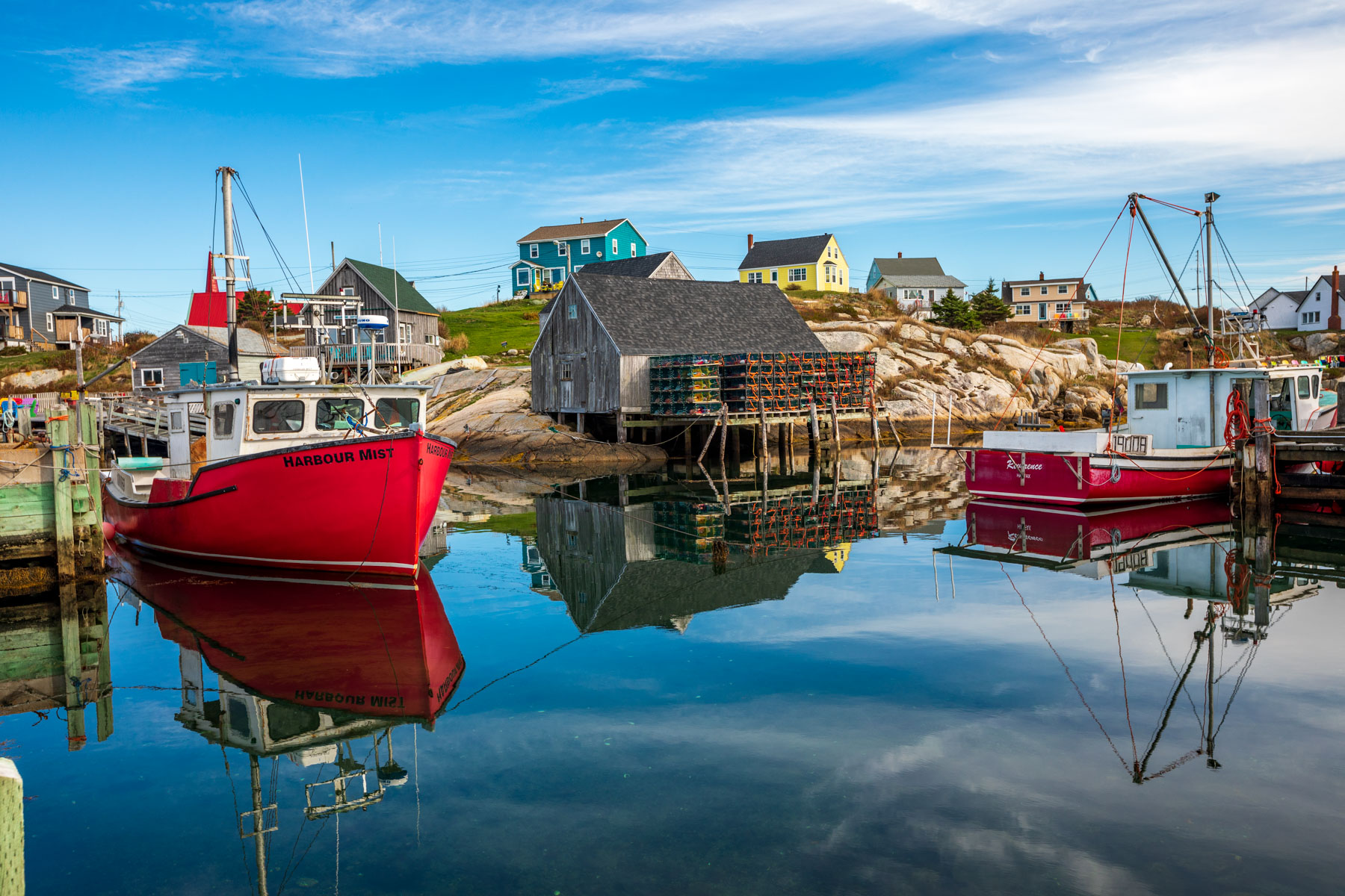 Peggy's Cove fising boats and huts, Nova Scotia, Canada