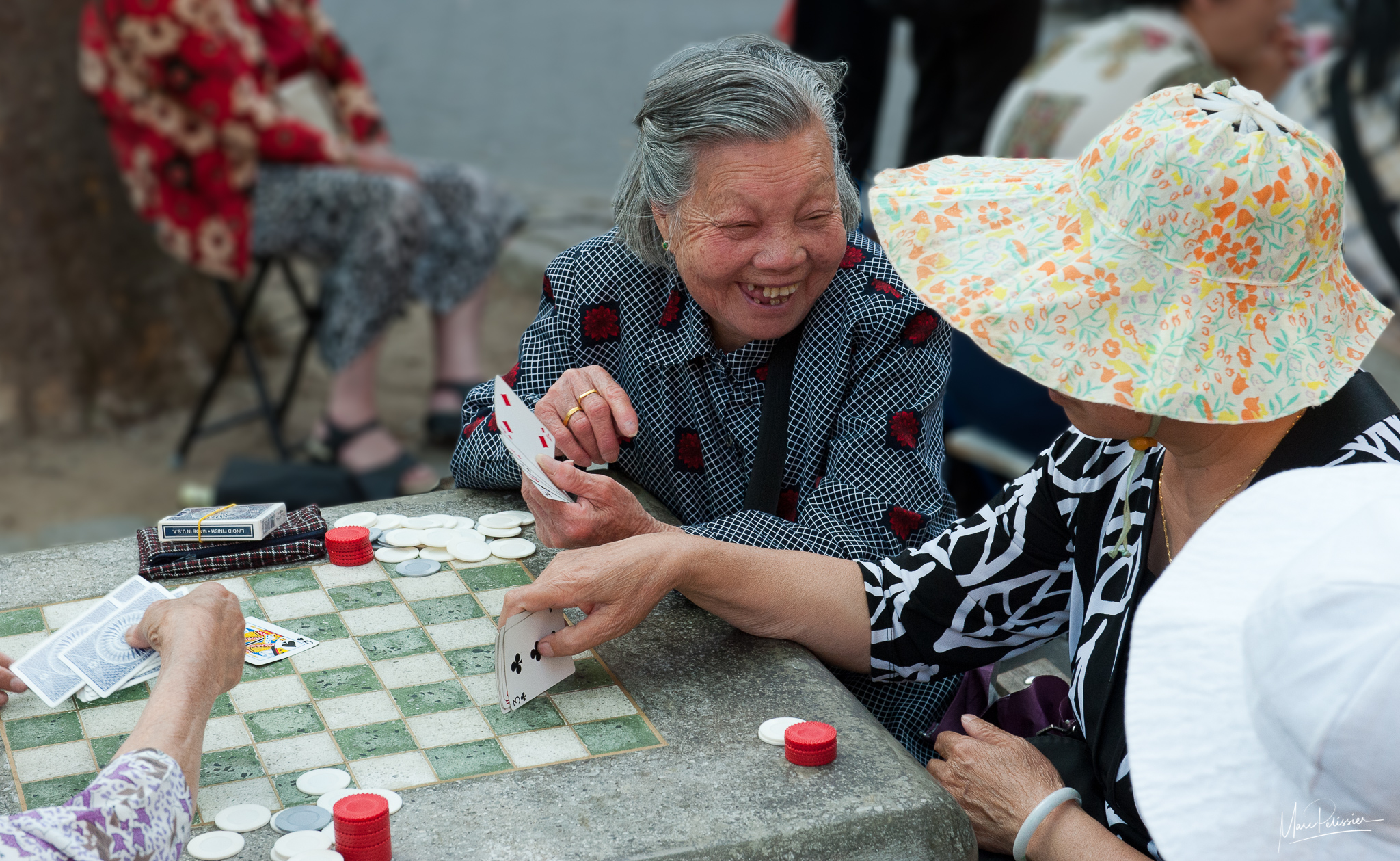 Sunday card play in Colombus park, USA