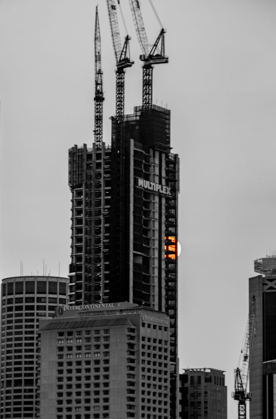 Sun disappearing behind a building Sydney harbour, Australia