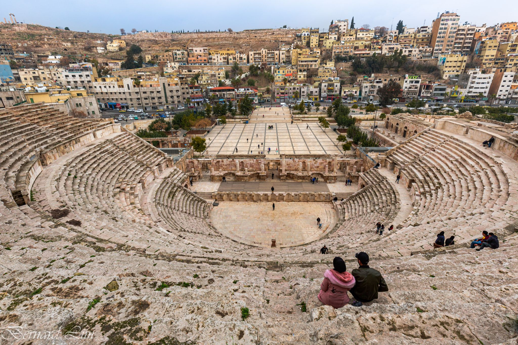 A young couple enjoying the view at the Roman Theatre, Jordan