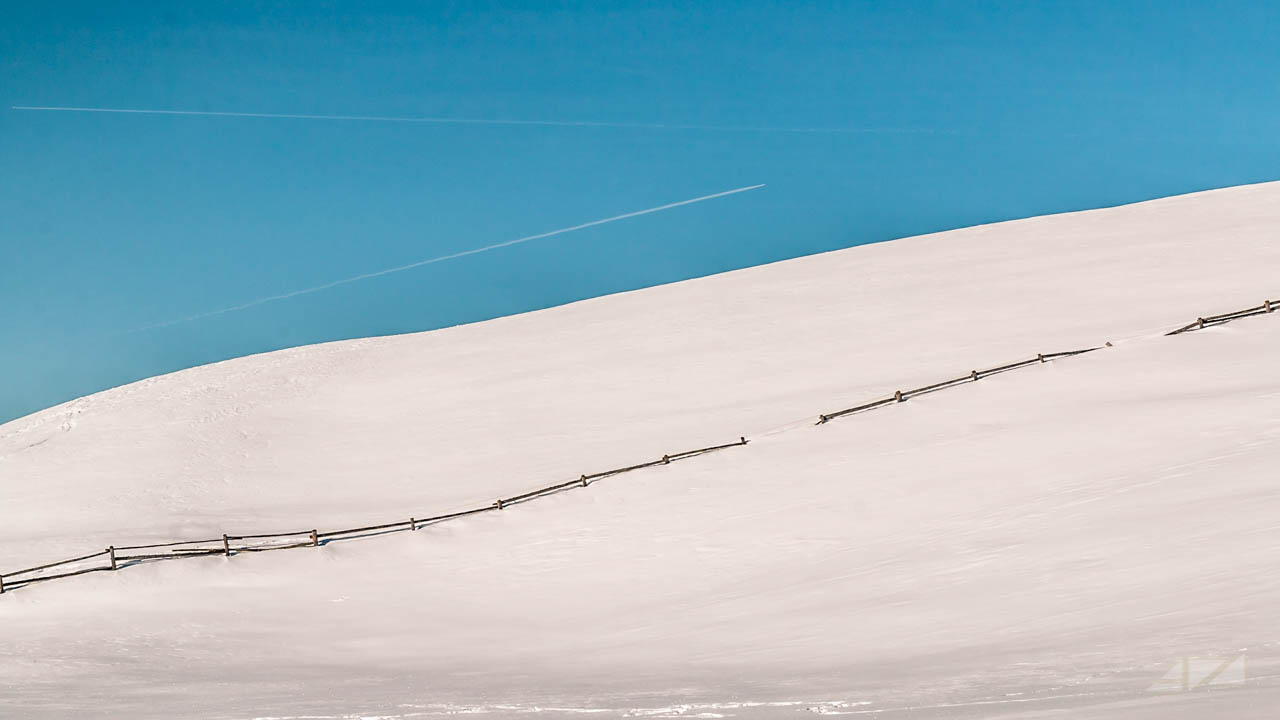 Railing and sky rows over  Rodenecker Alm, Italy