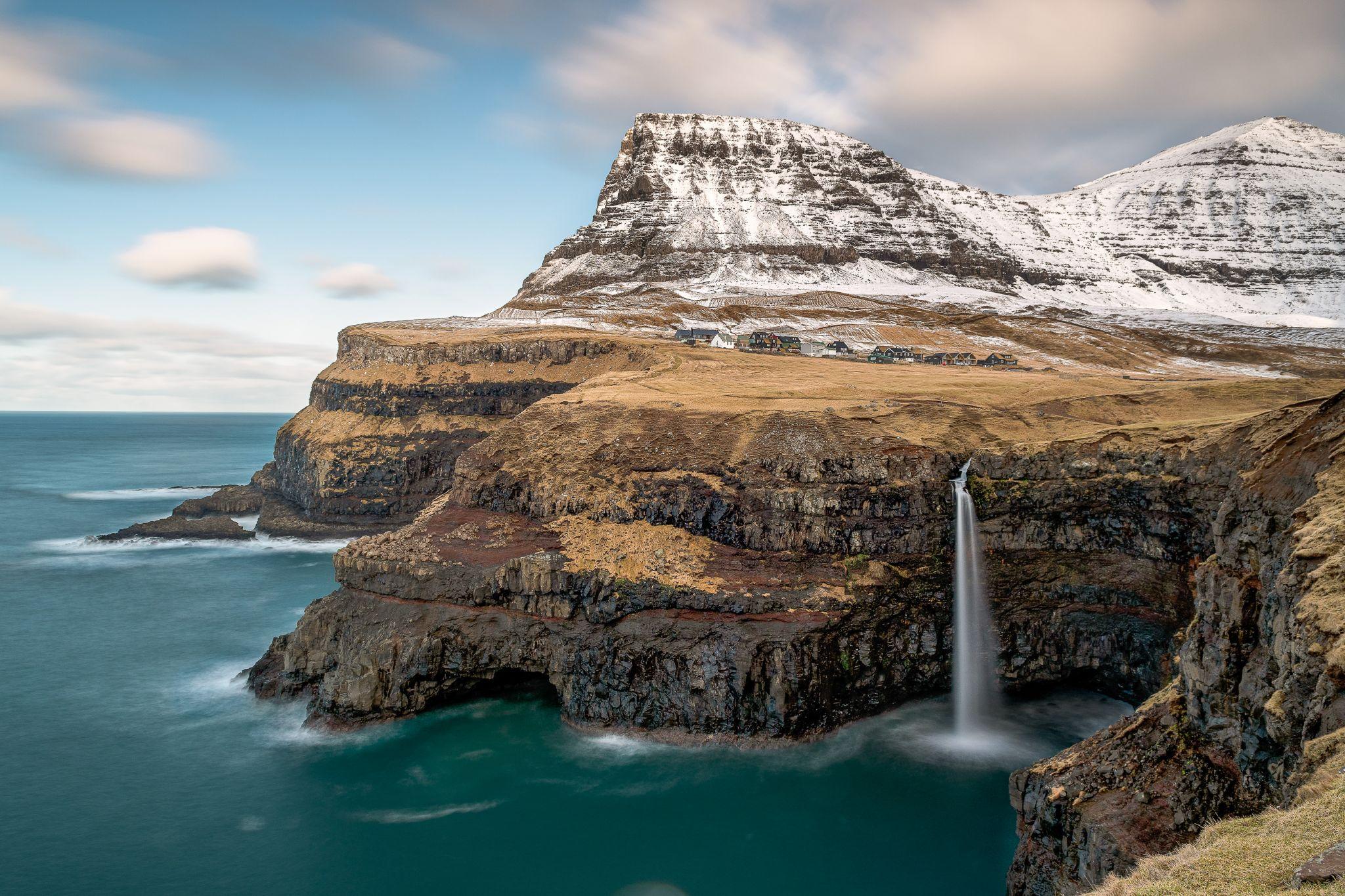 Gasadalur village and the Múlafossur waterfall, Faroe Islands