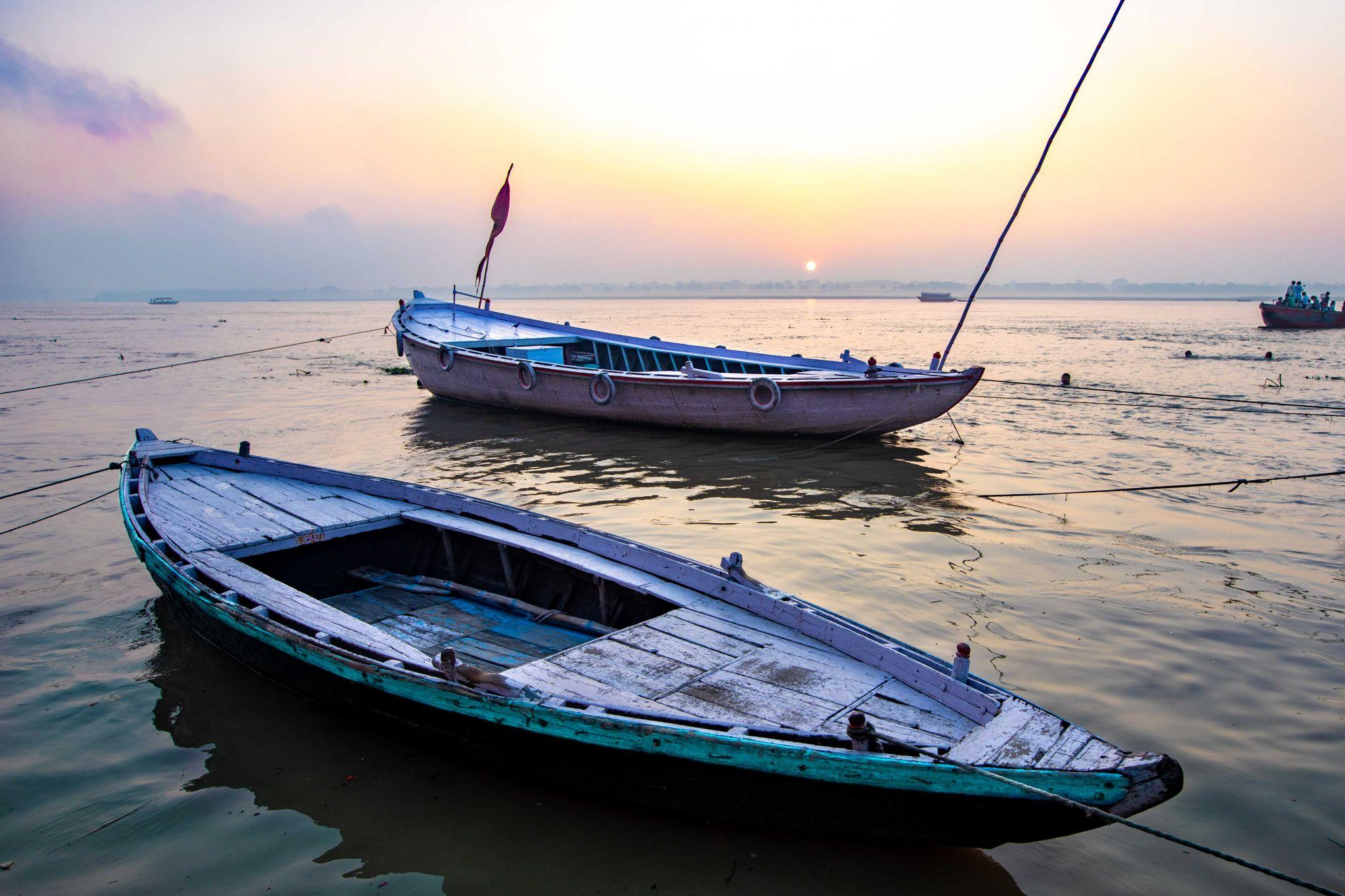 Boats on the Ganges at sunrise Varanasi, India