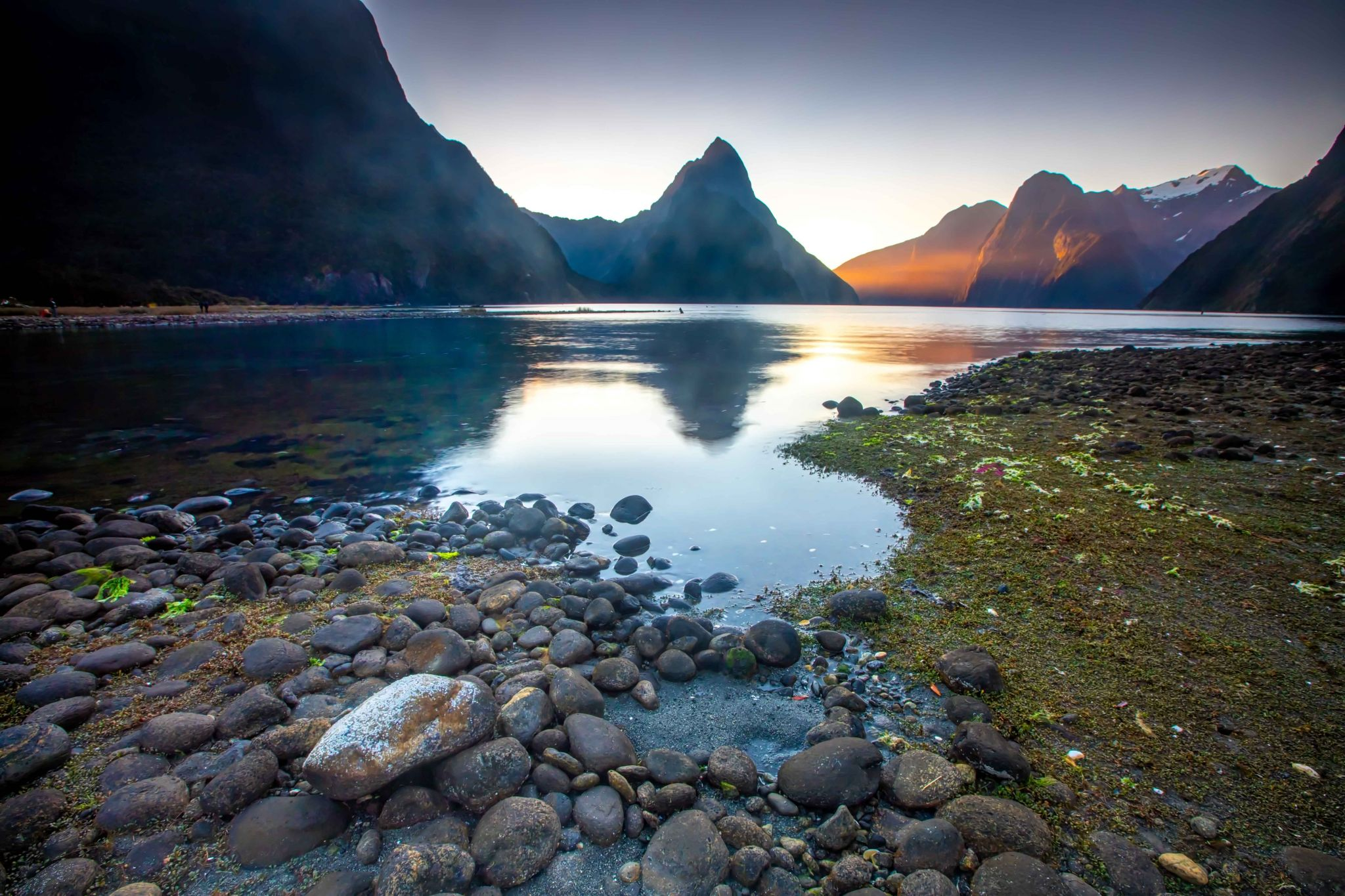 Milford Sound sunset with foreground  rock South Island, New Zealand